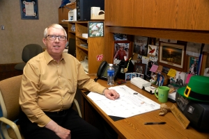 Dave Thorell, at his KRVN desk.